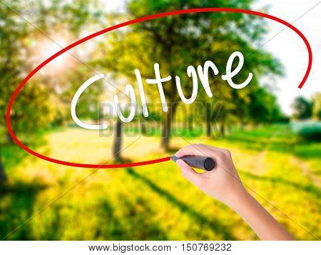 Woman Hand Writing Culture With A Marker Over Transparent Board