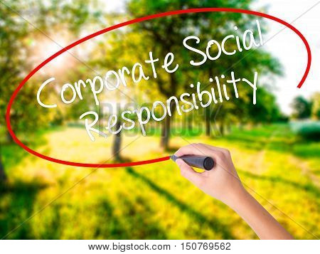 Woman Hand Writing Corporate Social Responsibility With A Marker Over Transparent Board .