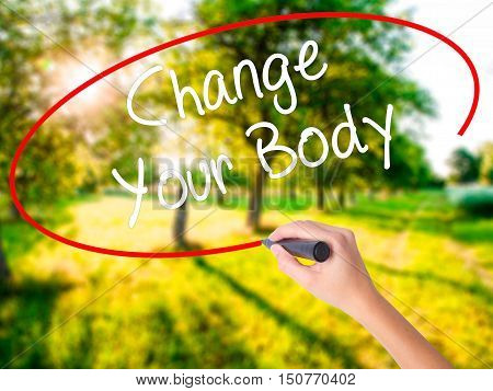 Woman Hand Writing Change Your Body With A Marker Over Transparent Board .