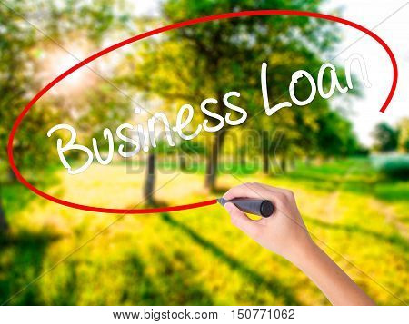 Woman Hand Writing Business Loan With A Marker Over Transparent Board