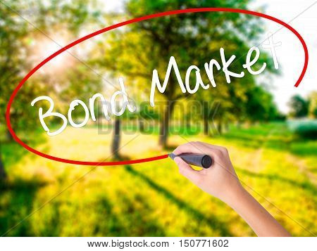 Woman Hand Writing Bond Market With A Marker Over Transparent Board