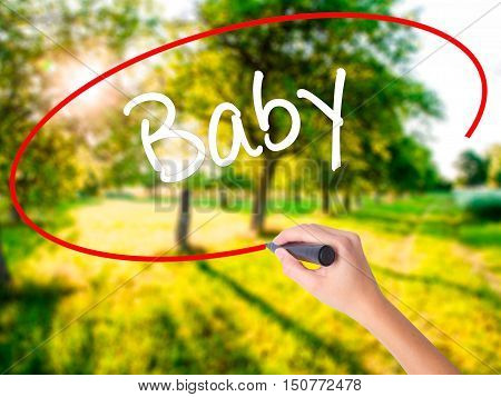 Woman Hand Writing Baby With A Marker Over Transparent Board