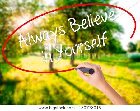 Woman Hand Writing Always Believe In Yourself With A Marker Over Transparent Board