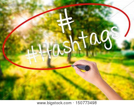 Woman Hand Writing #hashtags  With A Marker Over Transparent Board