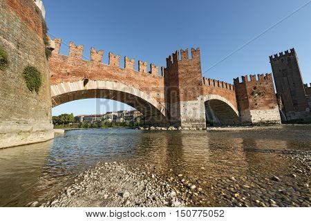 The ancient Scaligero bridge near Castelvecchio (Old Castle) and Adige river in Verona (UNESCO world heritage site) - Veneto Italy