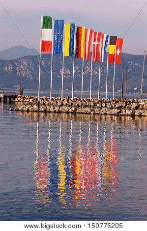 European flags in the port of Cisano on Garda Lake (Lago di Garda) a small village of the small town of Bardolino Verona Veneto Italy Europe