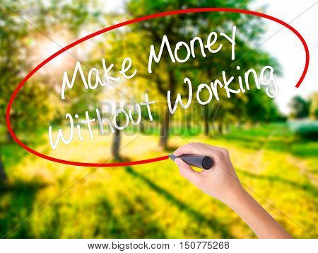 Woman Hand Writing Make Money Without Working With A Marker Over Transparent Board