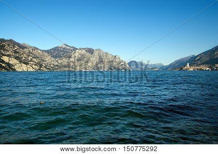 The Garda Lake in winter (Lago di Garda) with mountains and the ancient small town of Malcesine Verona Veneto Italy Europe