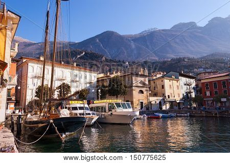 The port and downtown of the ancient small town of Malcesine in the Garda lake coast. Verona Veneto Italy