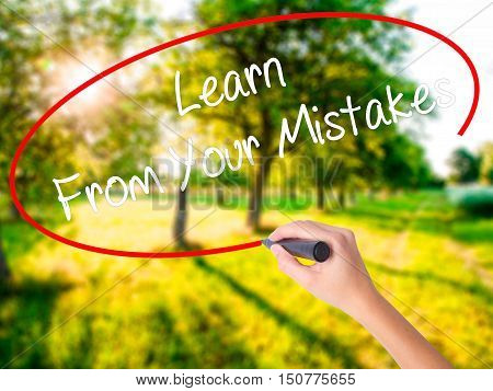 Woman Hand Writing Learn From Your Mistakes  With A Marker Over Transparent Board