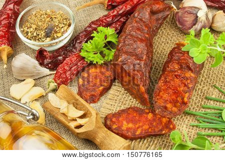 Homemade spicy pepper sausage. Homemade rustic sausages and chili. Sharp traditional food. Traditional butchers. Spicy delicacy. Advertising on butcher.