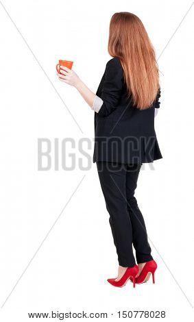 Rear view of a young business woman drinking coffee or tea while relaxing.  Young girl in suit.  Rear view people collection.  backside view of person.  Isolated over white background.