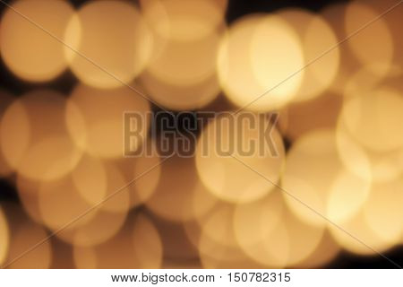 golden bokeh on a black background abstract dark backdrop with defocused warm lights