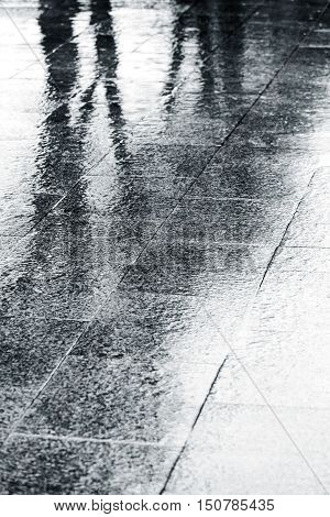 Wet Street Pavement With Raindrops Rippling In Puddles