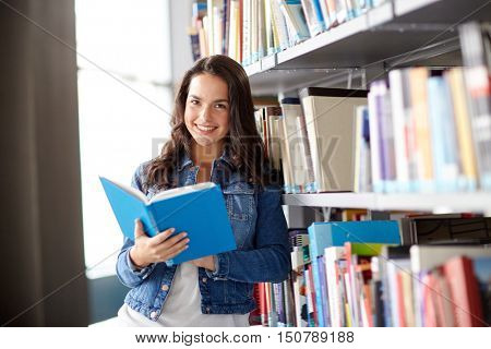 education, high school, university, learning and people concept - smiling student girl reading book at library