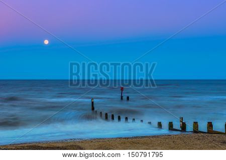 Southwold beach at sunset with wooden groynes