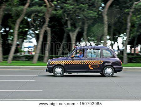 BAKU AZERBAIJAN - SEPTEMBER 25: Cab taxi in the street of Baku on September 25 2016. Baku is a capital and largest city of Azerbaijan.