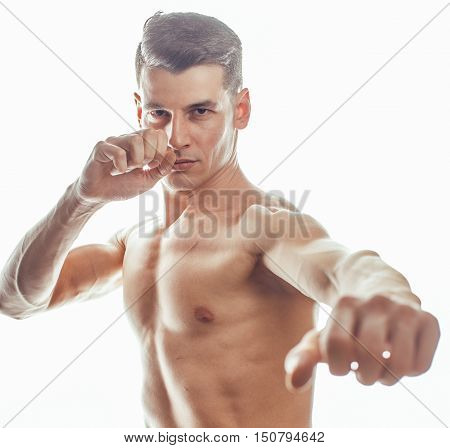 young handsome naked torso man boxing on white background isolated, lifestyle sport happy real people concept close up