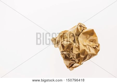 Crumpled brown paper isolated on white background