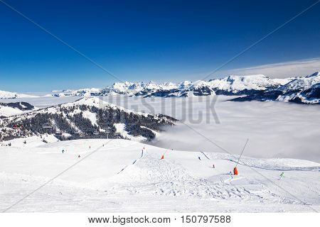 View to Alpine mountains and ski slopes in Austria from famous Kitzbuehel ski resort with 54 cable cars 170 km prepared skiing slopes and place of famous Hahnenkamm races.