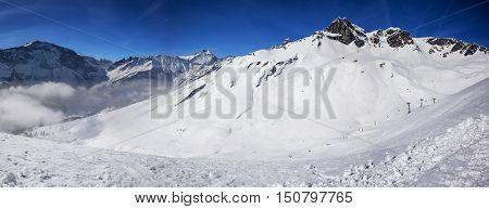Panorama view to chair lift in Elm ski resort Swiss Alps Switzerland