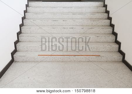 Close up way Up the Stairs terrazzo marble floor