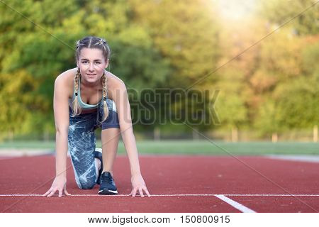 Athletic Young Woman In The Starter Position
