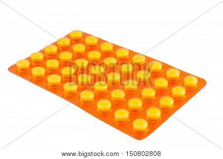Blister yellow tablets isolated on white background