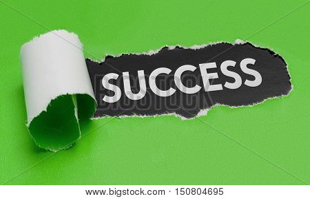 Torn Green Paper Revealing The Word Success