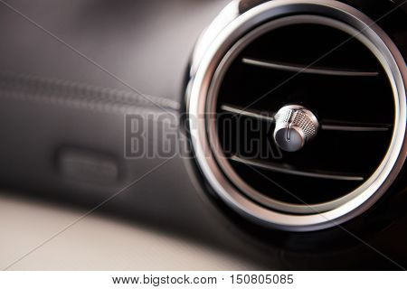 modern car interior, air conditioning hole. Close up