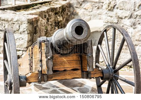 Close up photo of historic cannon. Retro object. Military theme.
