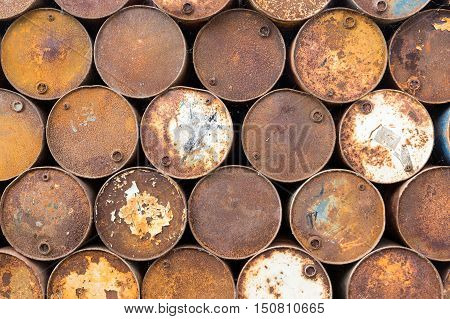 Brown background of old rusty oil barrels