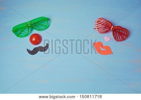 Carnival background with male and female funny party glasses. View from above
