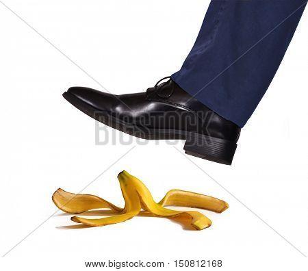 Foot stepping on banana skin.