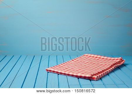 Empty wooden blue table with tablecloth. Kitchen background