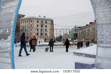 Murmansk, Russia - January 28, 2015: Residents go on Lenin Street on the eve of New Year holidays.