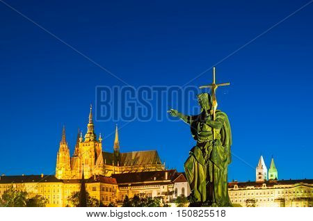 View on St.Vitus cathedral in Prague Castle from Charles bridge at night Czech Republic. Front focus