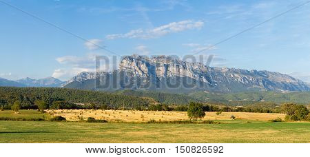Spain- Pena Montanesa and the open fields near Ainsa town in the Pyrenees
