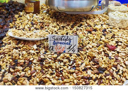 A mixture of nuts in the grocery market. On the price tag says