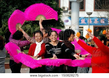 Pengzhou China - January 6 2008: Members of a women's waist drum band rehearsing a routine in New Square
