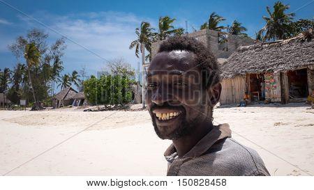 NungwiZanzibar/Tanzania - January 26 2016: Black local man smilling beach with palms