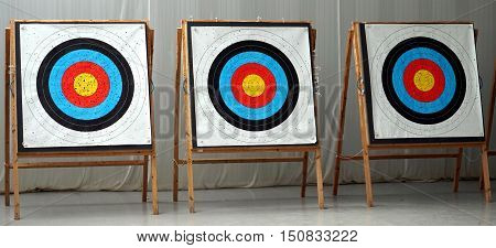 Three archery targets lined up for archers to shoot at