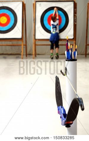 A Young Archer Retrieves His Arrows From The Target