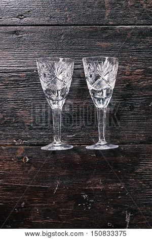 Still life with two empty wineglasses on the dark wood. Flat lay