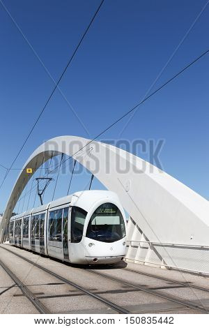 Tramway on a bridge near Confluences in Lyon, France