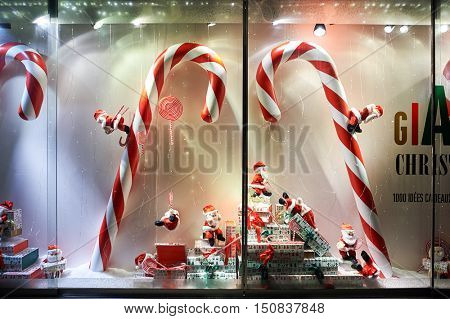 GENEVA, SWITZERLAND - NOVEMBER 18, 2015: Christmas decorations at night. Christmas or Christmas Day is an annual festival commemorating the birth of Jesus Christ observed most commonly on December 25.