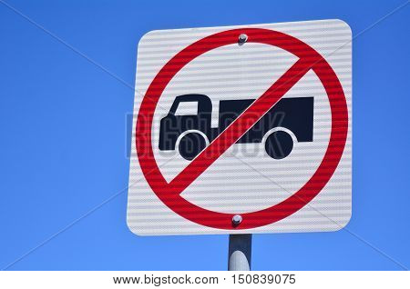 No heavy goods vehicles traffic sign and symbol against blue sky. concept