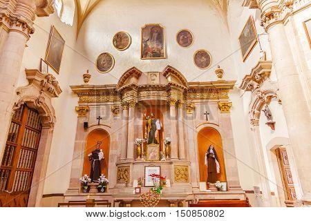 GUANAJUATO, MEXICO - DECEMBER 30, 2014 Jesus Monk Priest Nun Statues Basilica Templo De La Compania Christmas Guanajuato Mexico. Built by the Jesuits between 1746 to 1765.