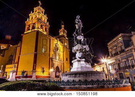 Our Lady of Guanajuato Paz Peace Statue Night Guanajuato Mexico Statue donated To City by Charles V Holy Roman Emperor in the 1500s. Steeple Towers Basilica de Nusetra Senora Guanajuato Mexico