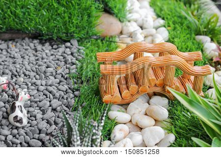 bridges Select focus with shallow depth of field garden in pot with stone park
